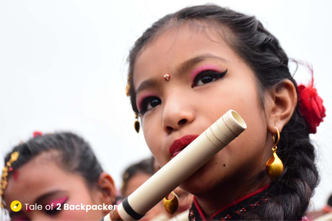 A little girl playing flute at Bisket Jatra