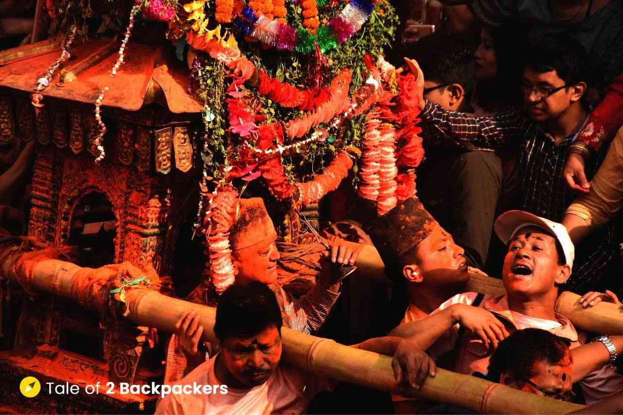 People carrying the palanquins on their shoulders at Sindoor Jatra