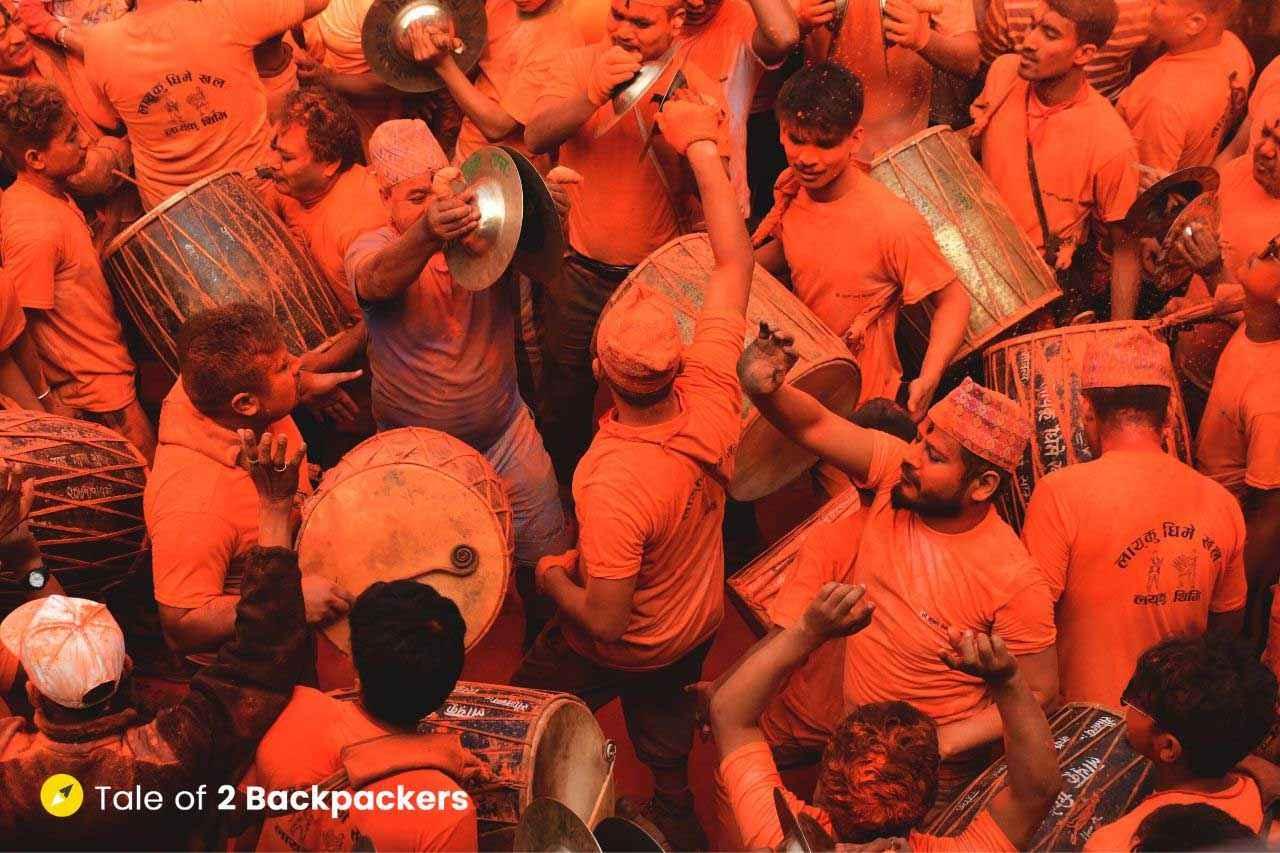 People playing drums at Sindoor Jatra in Thimi